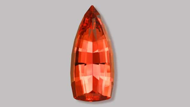 """27.23 ct Imperial Topaz, flame shape. 1st Place Other Faceted Category, 2007. Faceting by John Dyer. Mandatory credit: """"Gem [or specific gem name] courtesy of John Dyer & Co."""""""