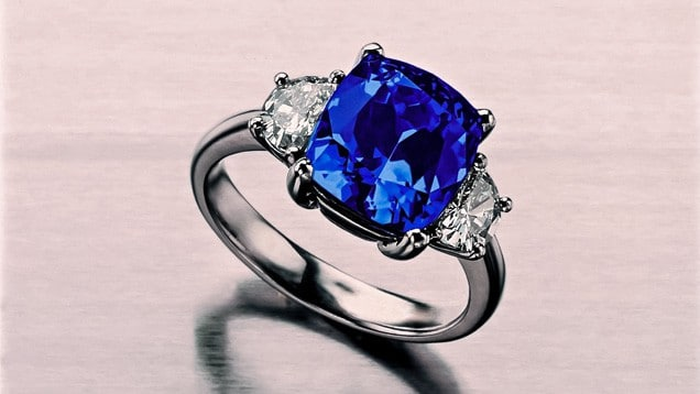 Cushion cut tanzanite ring with diamonds