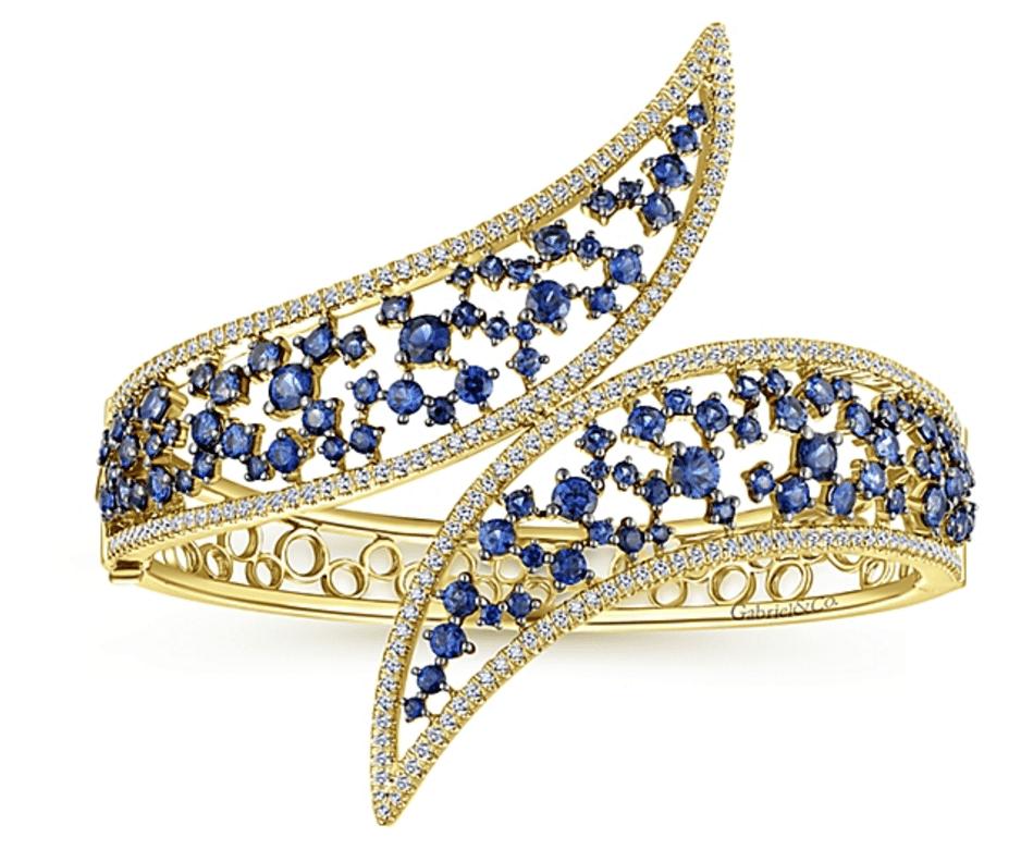 Statement Bracelet Gabriel Co New York Yellow Gold & Sapphire Bracelet 4 Types of Statement Jewelry Brittany's Fine Jewelry Gainesville FL