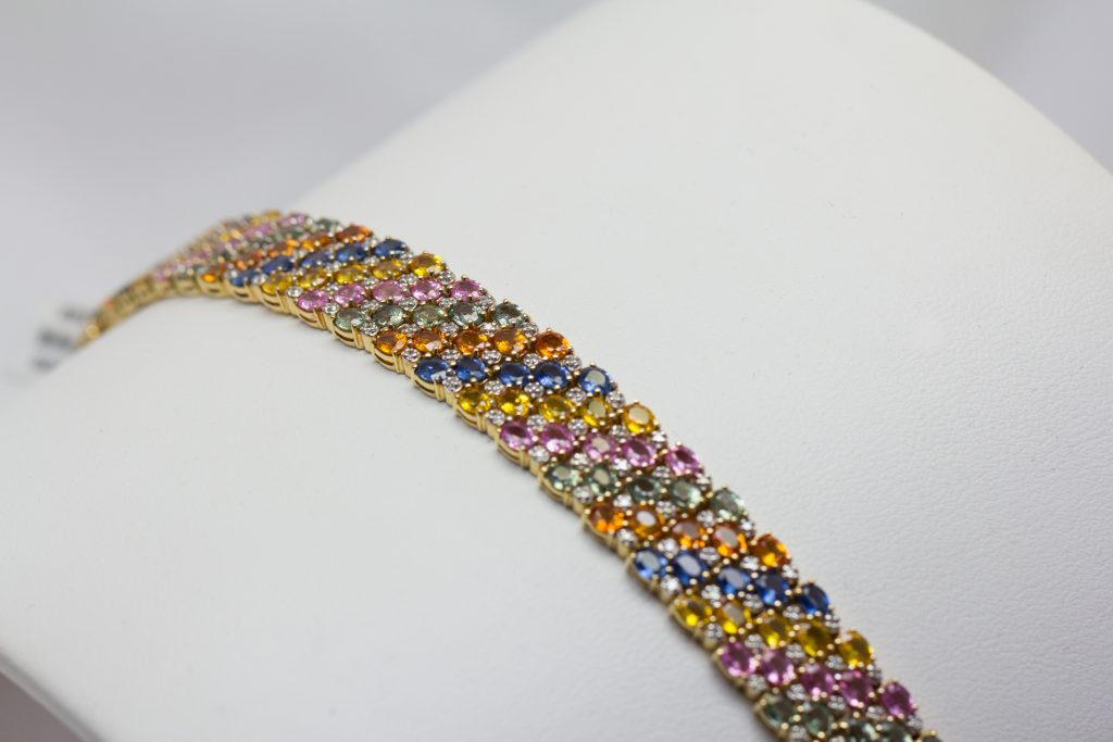 gemstone bracelet with blue yellow pink orange stones