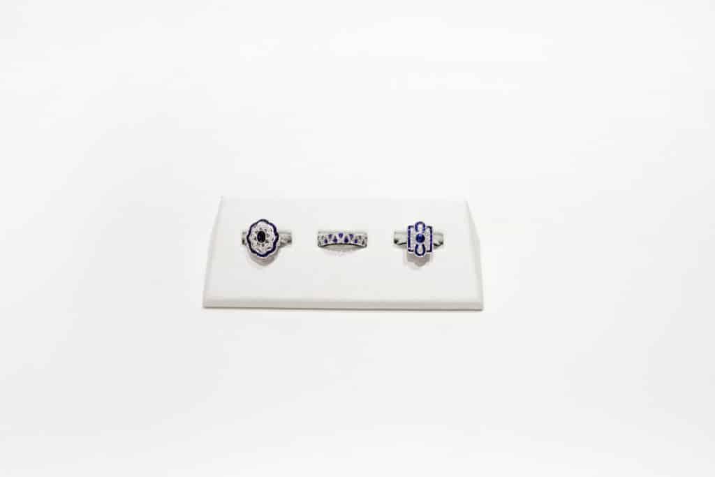 set of three blue gemstone and diamond rings